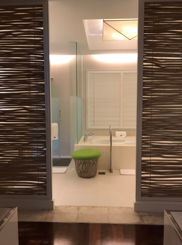 The bathroom - roomy with walk in wardrobes, a bathtub and a separate shower